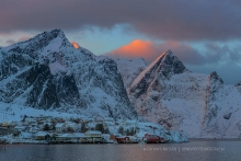 Sun is touching the mountain peaks in Lofoten